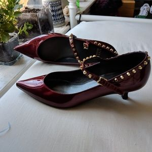 Stuart Weitzman red + gold studded kitten heels